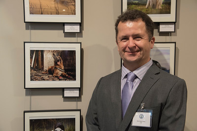 Robert James Dray next to his award winning Dogs at Work photograph