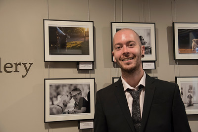 Michael Higginson Winner Assistance Dogs and Dog Charities category next to his award winning photograph