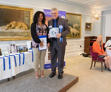 Rogerio Silva Arajuo from Brazil, 2nd Place Portrait Winner being presented his award by Kennel Club Member, Pauline Luxmoore-Ball