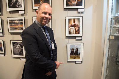 Jonathan Yearsley next to his award winning photograph for Oldies category