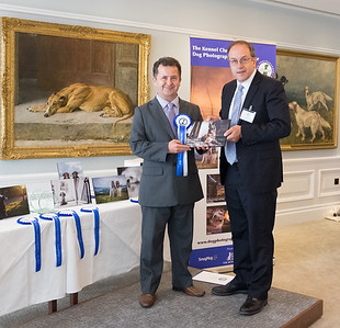Rob Dray 2nd place winner Dogs at Work being presented his award by Judge, Martin Keene from Press Association