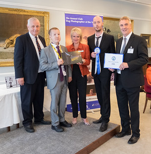 Michael Higginson Winner of Assistance Dogs and Dog Charities category with Chairman of the Kennel Club Simon Luxmoore, Dogs for Good Chief Executive , Peter Gorbing, Chief Executive of the Kennel Club, Rosemary Smart and special VIP guest Dale (Brother of Michael Higginson)