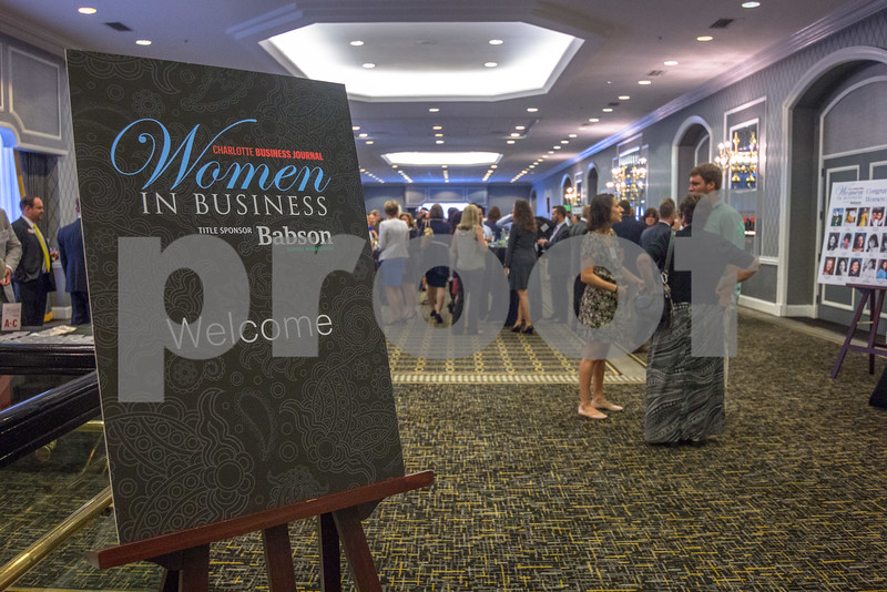 Attendees of the 2015 Women In Business Awards mingle before the dinner and ceremony.