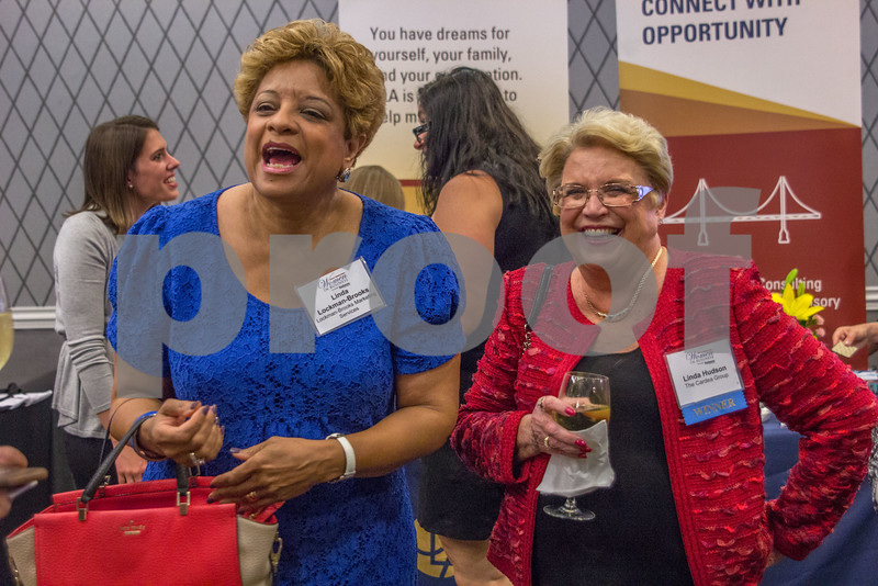 Attendees of the 2015 Women In Business Awards mingle and explore booths before the dinner and ceremony.