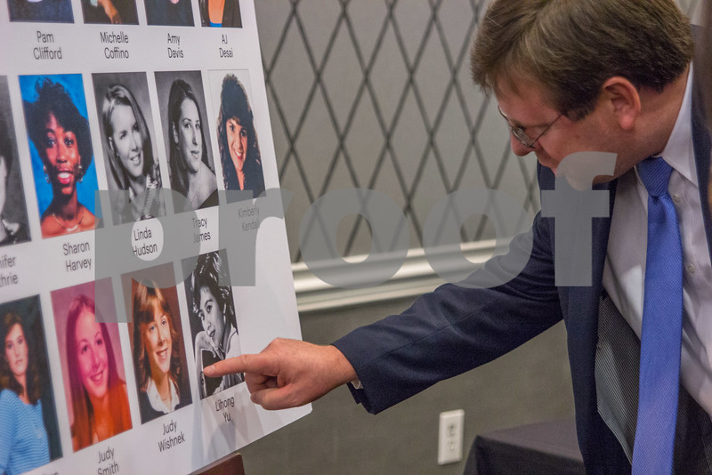 Attendees of the 2015 Women In Business Awards view a roster of high school photos of each of this years winners before the dinner and ceremony.