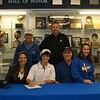 FHS golf player C. Hayford has signed a letter of intent to play Men's Golf for St. Edward's University in Austin. His major is Environmental Science and Policy. He is the son of Timothy and Cynthia Hayford. They are joined for a photo with FHS Golf Coach, Bob Crotteau. Golf Swing Coach Doug Strawbridge and Corey's sister, A. Hayford.