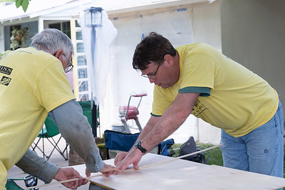 Volunteers work on the Blair home in South Sacramento during Rebuild Day on April 25, 2015. (Photo by Leilani Paular)