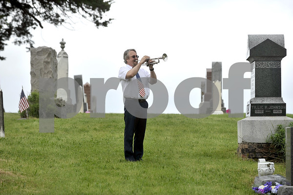 "-Messenger photo by Hans Madsen<br /> <br /> Southeast Valley Middle School band instructor Dave Swaroff plays ""Taps"" Monday morning during the Dayton Memorial Day observance in the Dayton Cemetery."