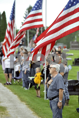 -Messenger photo by Hans Madsen<br /> <br /> John Sl LeValley, of Wichita, Kansas, puts his hand over his heart Monday morning during the Memorial Day observance in the Dayton Cemetery. LeValley was honoring three of his relatives that served and buried in the cemetery.
