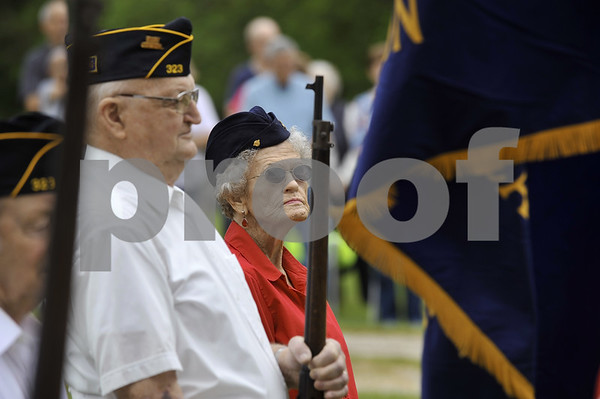 -Messenger photo by Hans Madsen<br /> <br /> Imogen Hanson, of Dayton, stands at attention along with Frank Fischer, also of Dayton, during the annual Memorial Day Observance in the Dayton Cemetery. Hanson served in World War II in the Navy Waves. Fischer served in the Army during the Korean War.