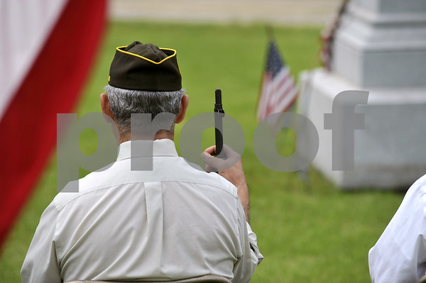 -Messenger photo by Hans Madsen<br /> <br /> Honor Guard member Leroy Jones, of Dayton, holds onto his M1 Garand Monday morning during the annual Memorial Day Observation in the Dayton Cemetery.