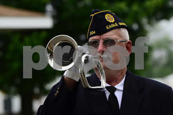 -Messenger photo by Jesse Major<br /> <br /> Eagle Grove American Legion Post 304 member John Asche performs taps during the Memorial Day service in Eagle Grove.