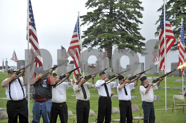 -Messenger photo by Hans Madsen<br /> <br /> Members of the Honor Guard fire a salute Monday morning in the Dayton Cemetery as part of the annual Memorial Day Observance.