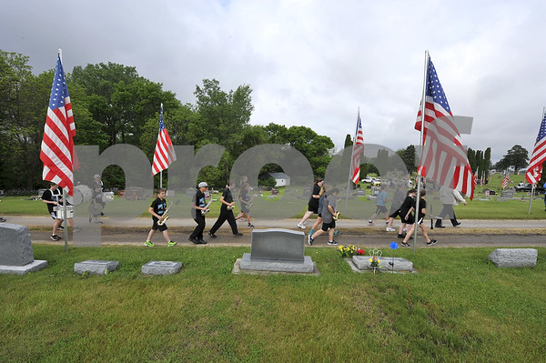 "-Messenger photo by Hans Madsen<br /> <br /> The Southeast Valley Middle School band marches into the Dayton Cemetery Monday morning to provide the music for the annual Memorial Day Observance. The students played ""Nearer My God To Thee"" and the ""National Anthem."""