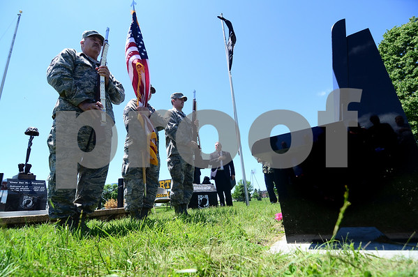 -Messenger photo by Jesse Major<br /> <br /> Members of the 133rd Air National Guard present the American flag during the dedication of te Vietnam Vetrans Memorial Bench outside the Fort Museum Monday.