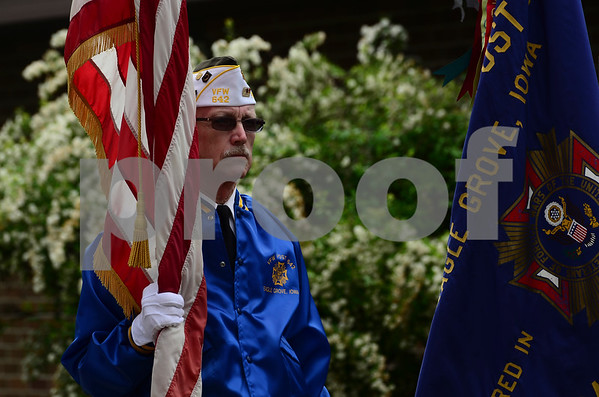 -Messenger photo by Jesse Major<br /> <br /> Ron Bliss, of the Veterans of Foreign Wars Post 642 in Eagle Grove holds an American flag during a Memorial Day service in downtown Eagle Grove.