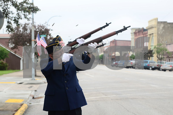 -Messenger photo by Jesse Major<br /> <br /> Mike Willie and other members of the Eagle Grove American Legion Post 304 perform a 21-gun salute to honor soldiers who died while serving in the Armed Forces.