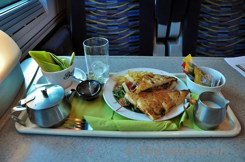 Lunch on board the 1300 Heuston - Cork. Herby Foccacia with honey roast ham, mozzarella & rocket with tomatade. Fri 20.02.15