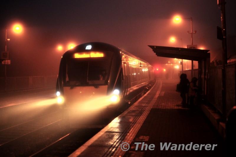 The headlights of 22057 pierce the fog at Portarlington. 1730 Portlaoise - Heuston. Thurs 22.01.15