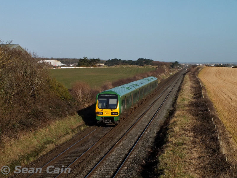 29028 passes Gormanston Airfield with the 0535 Rosslare Europort - Dundalk. This is the longest journey a 29000 Class does each day at just over 158 miles. Wed 04.03.15 <br> <br> Photo courtesy of Sean Cain.