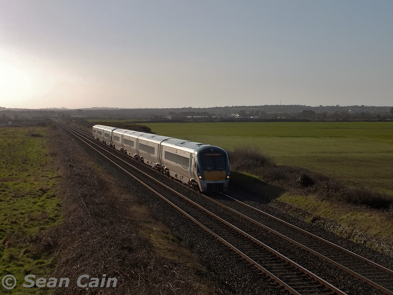 22018 + 22046 pass Gormanston Airfield with the 0900 (deferred to 0915 today) Connolly - Drogheda Ety. The sets had earlier worked the 0545 from Sligo to Connolly and were going to the DMU depot at Drogheda for examination. Wed 04.03.15 <br> <br> Photo courtesy of Sean Cain.