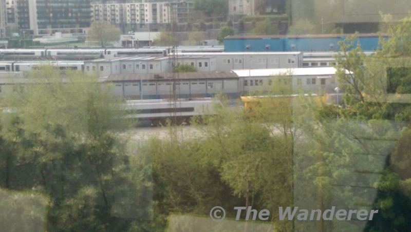 A camera phone photograph taken through the window of an office block, but its an interesting one which deserves a wider airing. (8)209 is pictured at Heuston's Guinness Yard with a rake of Autoballaster wagons after overnight engineering works. An unidentifed 071 was at the other end of the train. Wed 13.05.15