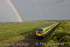 29018 is chased by a Rainbow at Gormanston Airfield with the 1821 Pearse - Drogheda. Mon 11.05.15<br /> <br /> Picture courtesy of Barry Pickup.