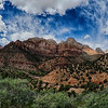 wide landscape view of a zion national park canyon valley