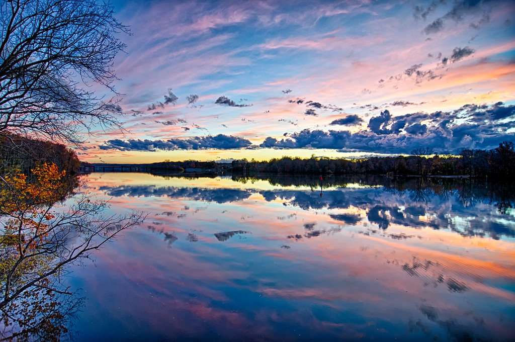 sunset and reflection with beautiful sky rainbow colors