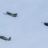 """The torpedo plane formation turning west toward the Mall. The """"Helldiver"""" is leading a pair of """"Avengers"""" in the formation."""