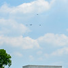 The Missing Man formation passing over the WWII Memorial on the Mall.