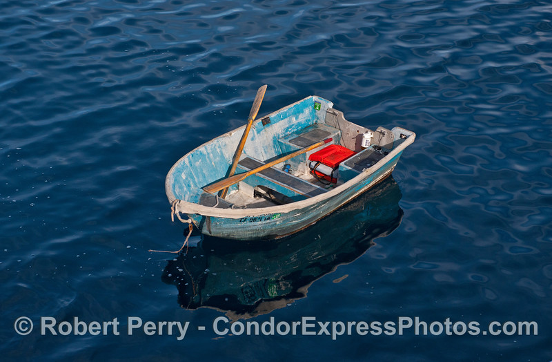 Derelict row boat found drifting many miles offshore.