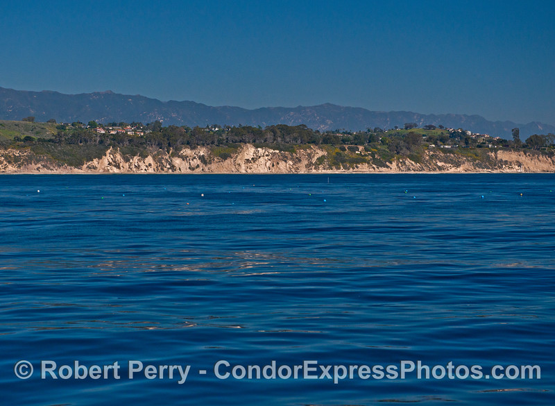 Image 2 of 2:  Surface floats marking and oyster farm.   Santa Barbara Mariculture company.