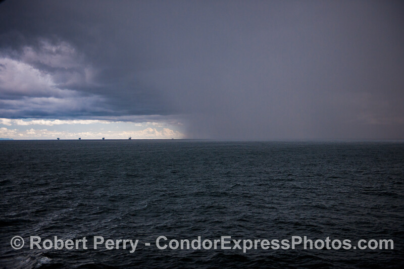 Oil platforms C, B, A and Hillhouse with rain squall.