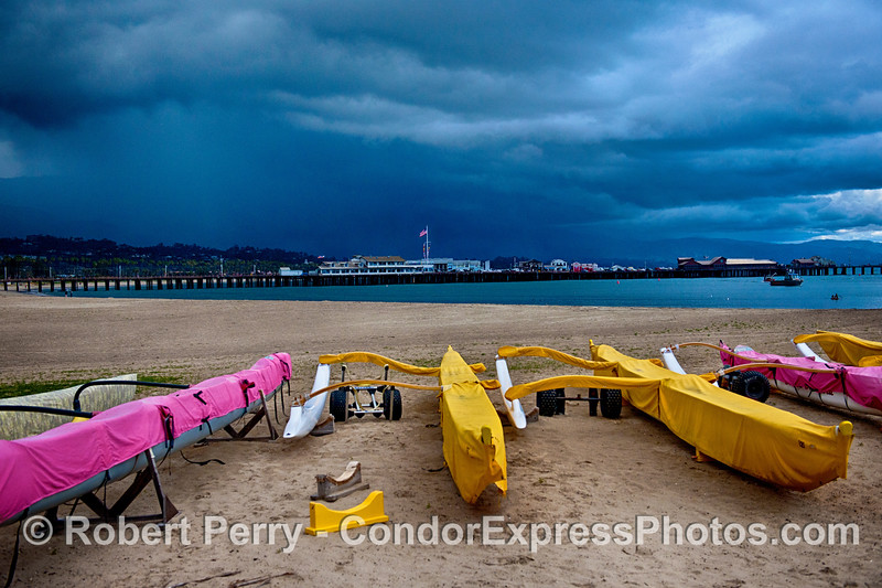 Outriggers on West Beach Santa Barbara, Stern's Wharf and rain squall.