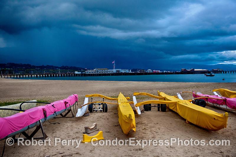 Outriggers on West Beach Santa Barbara, Stern's Wharf and rain squall.