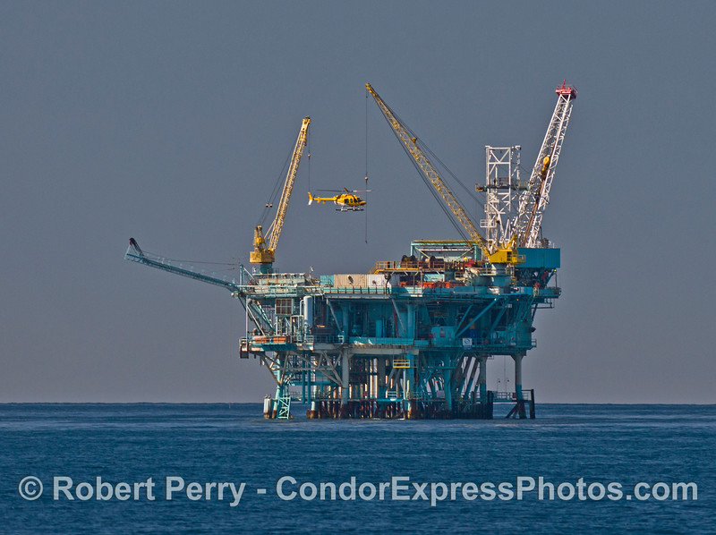 "Offshore oil Platform ""B"" and a yellow helicopter."