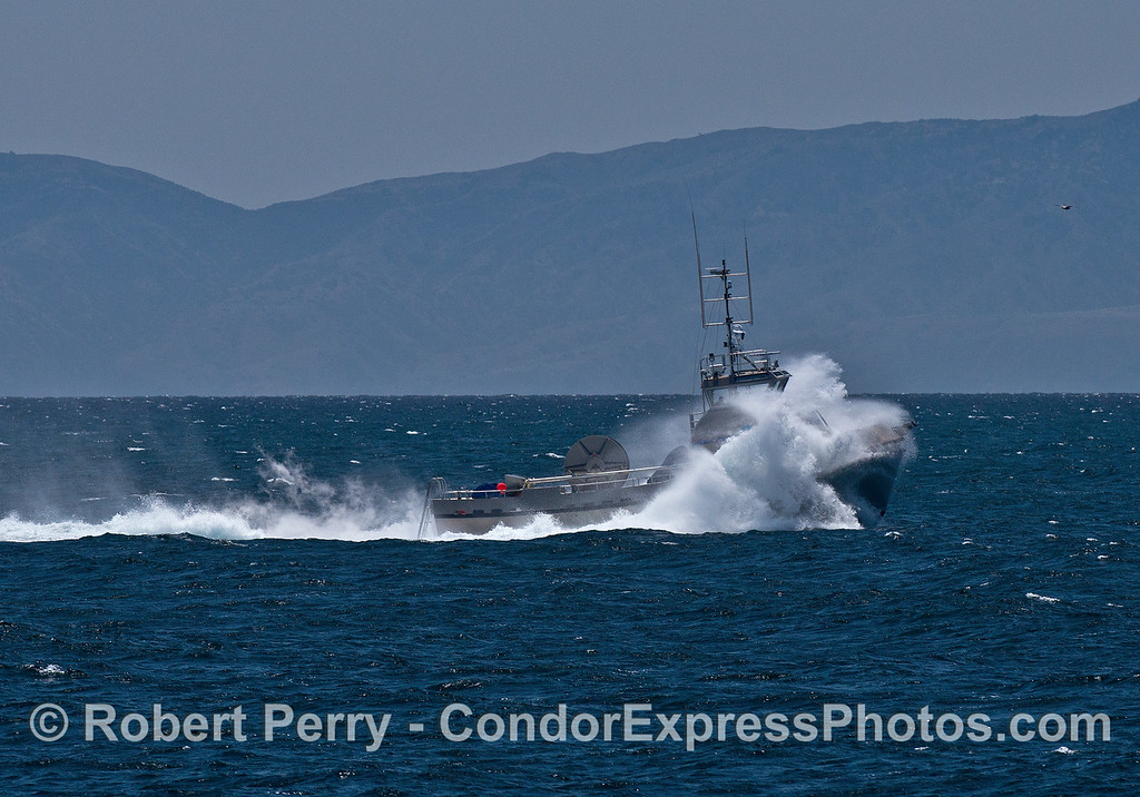 "The oil spill response vessel ""Ocean Defender"" heads into the prevailing wind and swell."