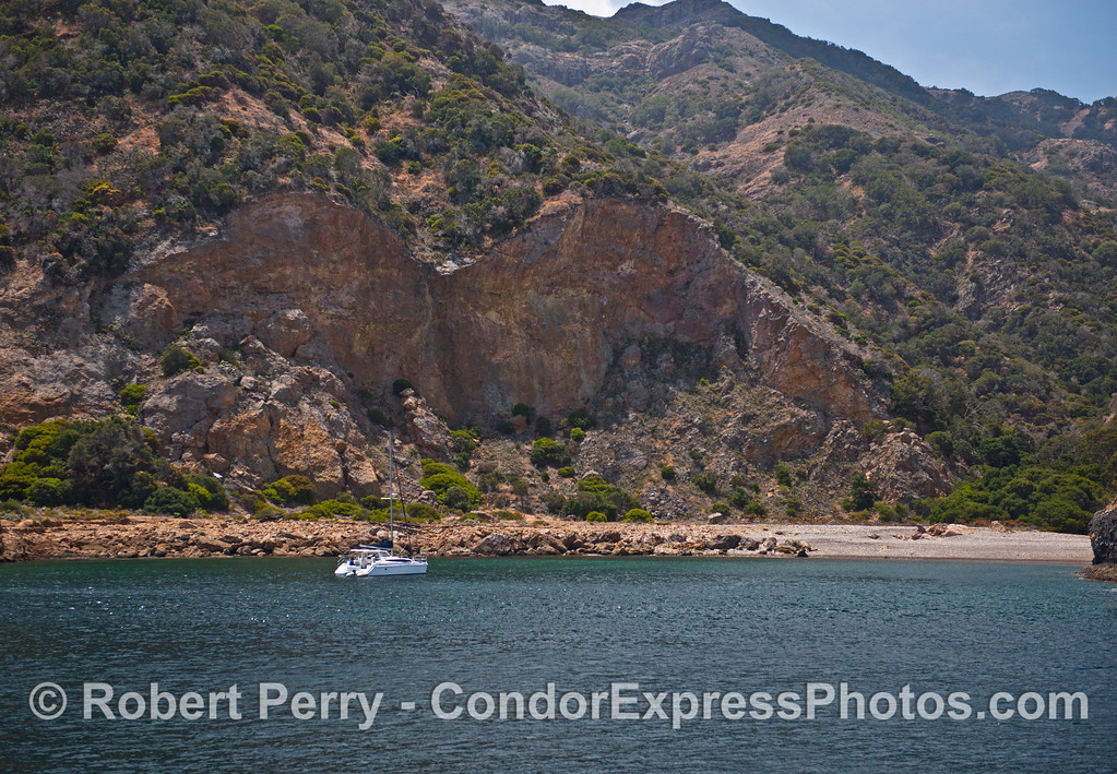 Beautiful Fry's Anchorage, Santa Cruz Island showing the rock faces exposed by taking rock for the Santa Barbara Harbor breakwater which was completed in 1929