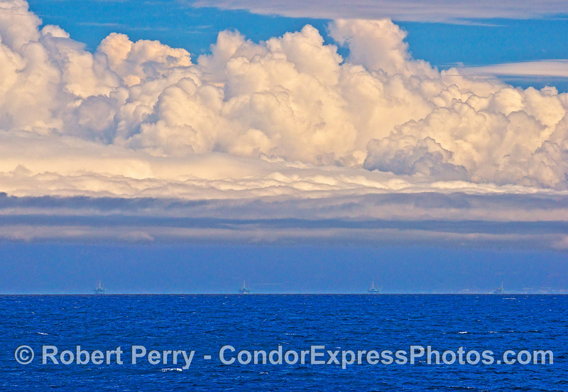 Cloud formation over the mainland with offshore oil platforms C, B, A and Hillhouse.