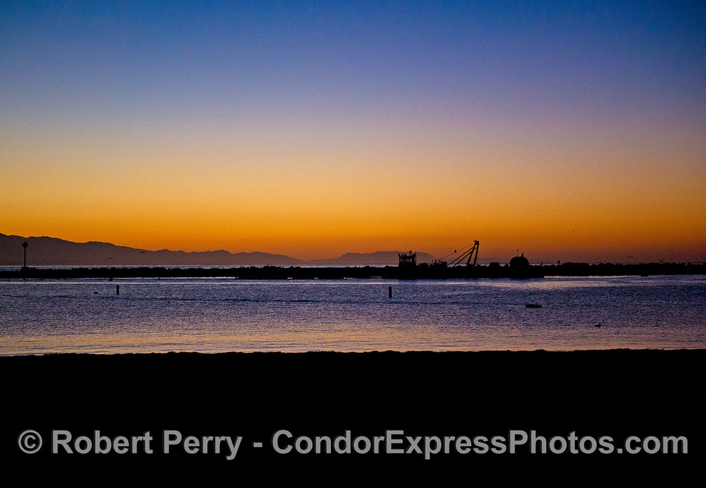 Sunrise - Santa Barbara Harbor - harbor dredge and Boney Ridge
