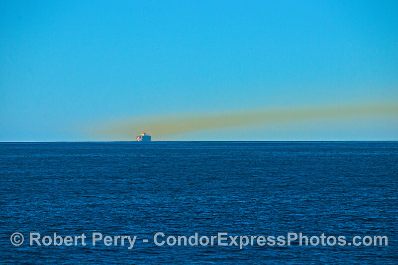 A second container ship leaves a smoke trail in the Santa Barbara Channel.