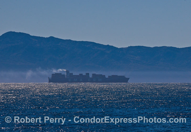 Another smoking northbound container cargo ship in the Santa Barbara Channel.  Santa Cruz Island, part of our national park, is seen in the back.