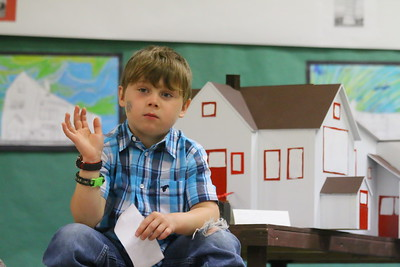 IMG_0472 - Coleman Waters - waving at someone in the audience, in front of a model of the BVS