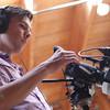 Christopher Harland-Dunaway (17') field reporting at Zukor Art Conservation during 2015 Multimedia Bootcamp. September 1, 2015. (UC Berkeley Graduate School of Journalism / Jieqian Zhang)