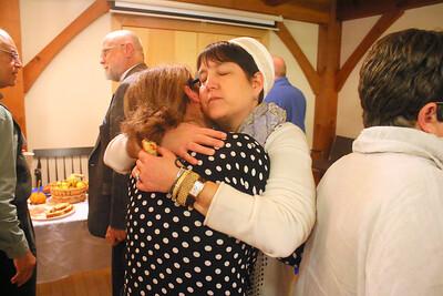 IMG_1477 Rabbi Ilene Haigh at right hugs bambi rivera after the service