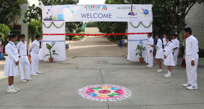 Waiting eagerly for the chief guest's arrival and the event to begin