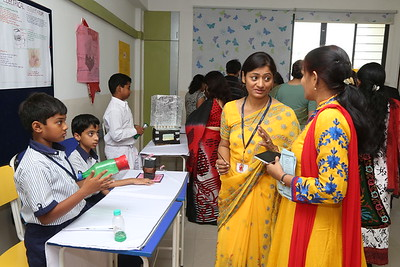 Parents busy interacting with teachers and students
