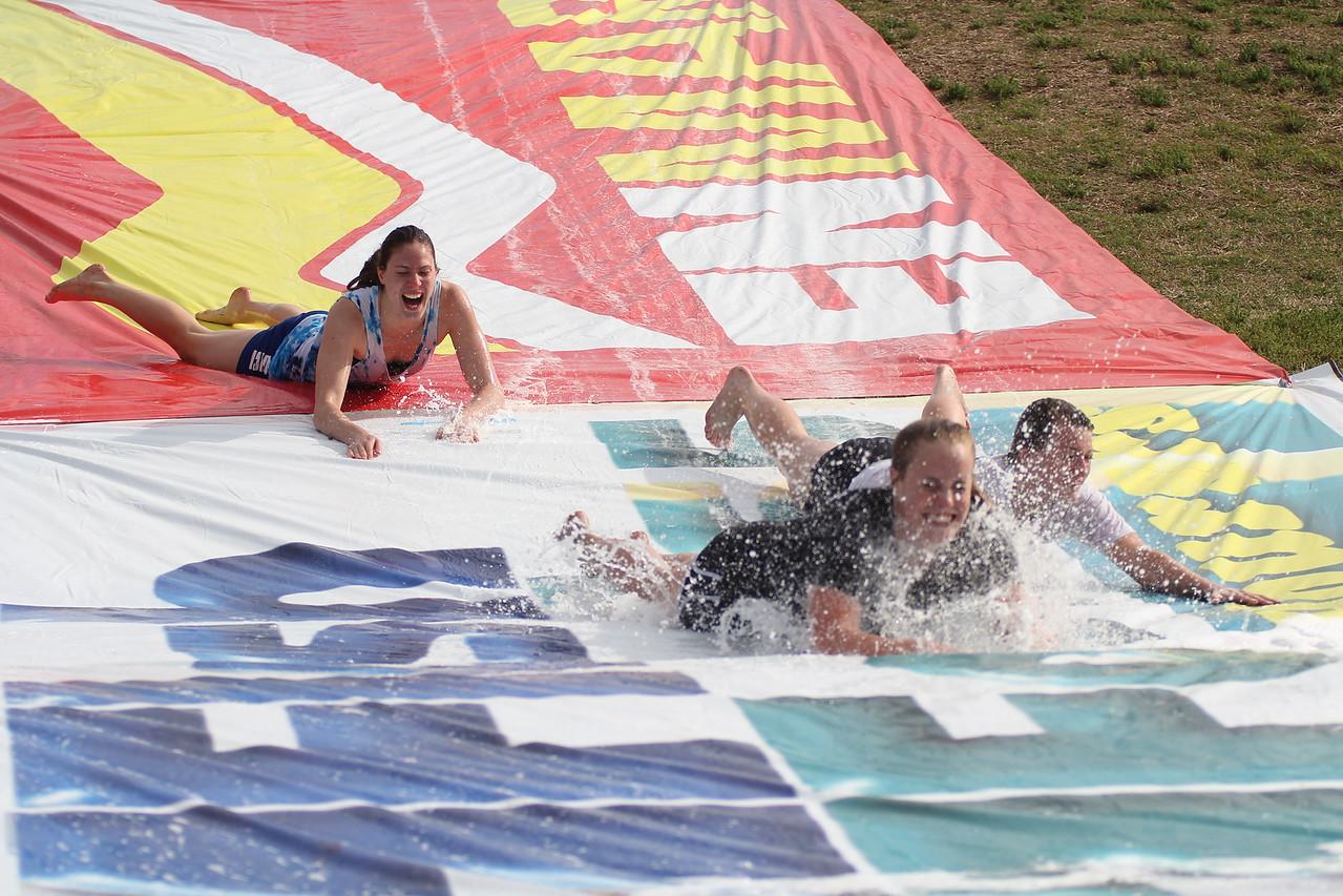 On Friday, May 1st, students took a break from their studies and kids from the community came and enjoyed some fun slip n' sliding down the hill at the soccer field. It was a great afternoon for all!