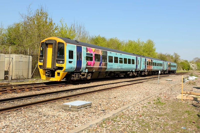 20 April 2015 :: The Gunwharf Quays advertising 158798 is seen passing Berkeley Road Junction working 1V94, the 0859 from Brighton to Great Malvern